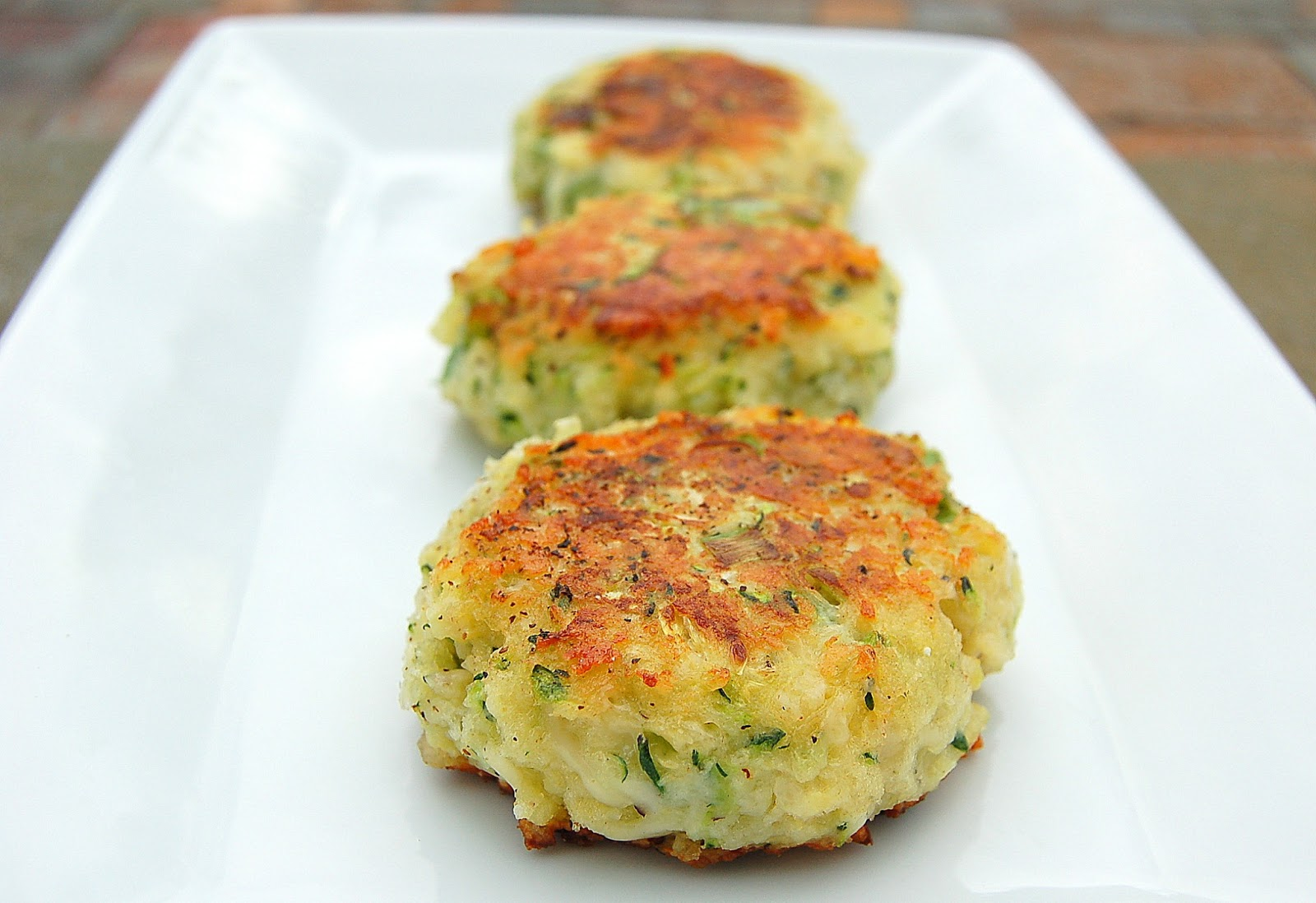 Zucchini Parmesan Cakes - A delicious way to use up all that summer zucchini!