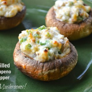 Grilled Mushrooms stuffed with Jalapeno Popper filling on a green plate