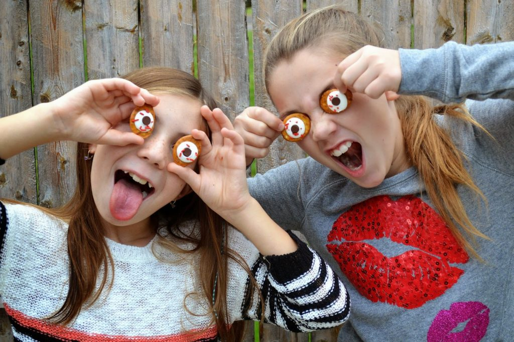 kids having fun with Halloween eyeballs they can eat