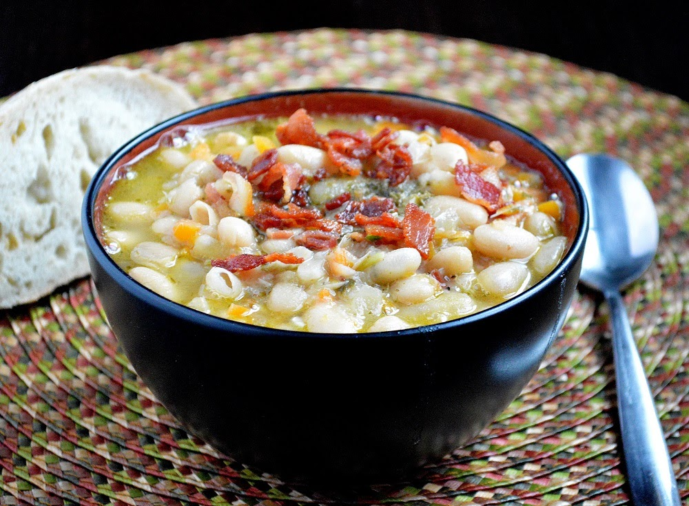 white bean bacon soup in a black bowl