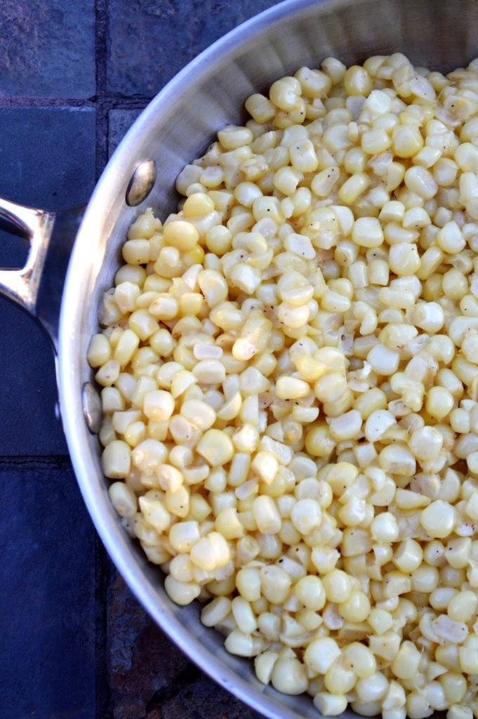 Fresh Corn cut off the cob, sauteed in butter and seasoned with salt