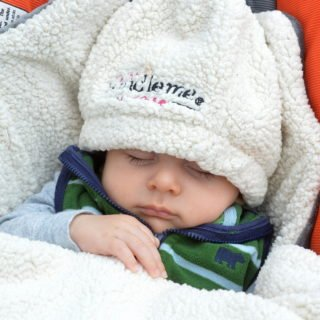 Baby in JJ Cole Bundleme and Bundleme Hat