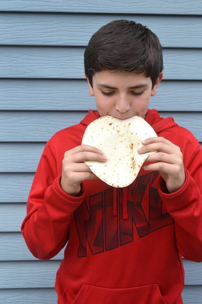 Boy eating a Mission Tortilla