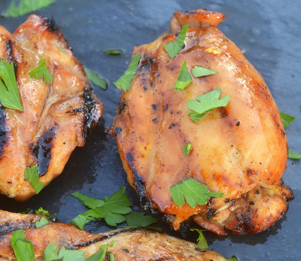 Grilled Sriracha Honey Chicken Thighs Who can resist these? A real crowd-pleaser and great for parties!