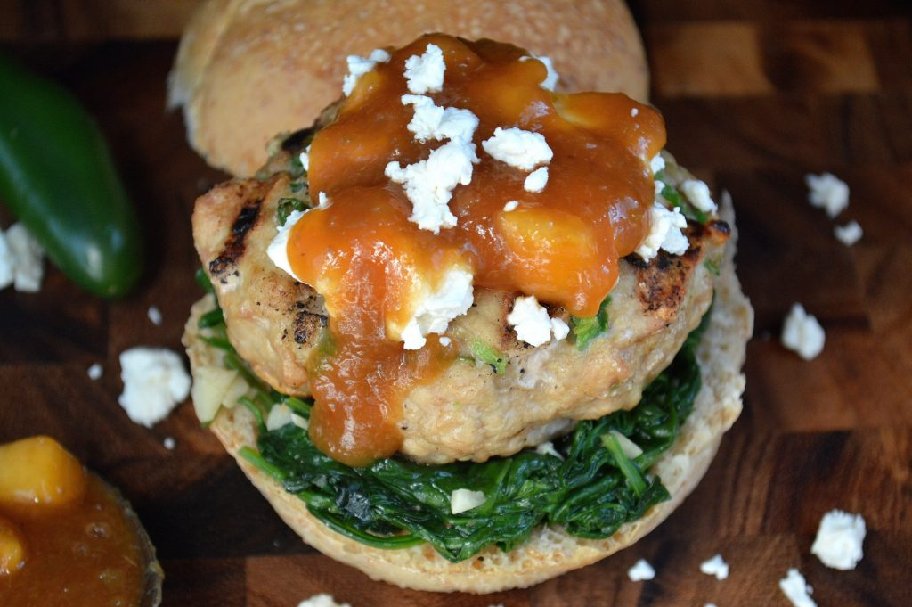 Jalapeno Chicken Burger with Bourbon Peach Jalapeno Sauce and Wilted Spinach