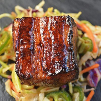 Slow Roasted Pork Belly Bites over Jalapeno Slaw.