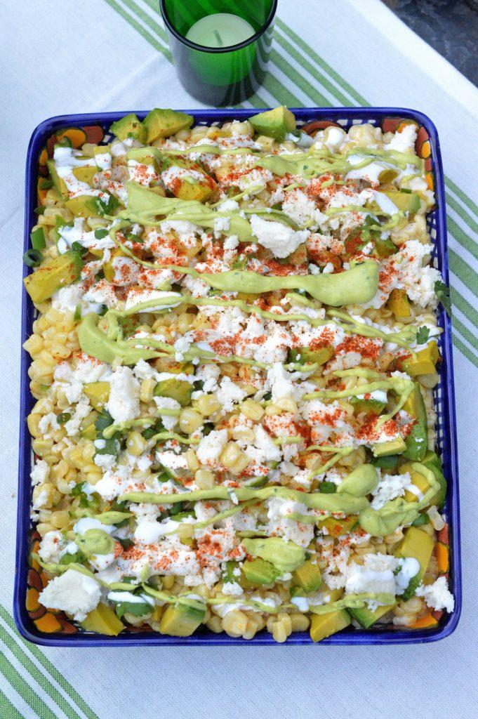 Mexican Street Corn Salad feautring avocados Cojita cheese, Mexican table cream & a Spicy Creamy Guacamole Dip Drizzle