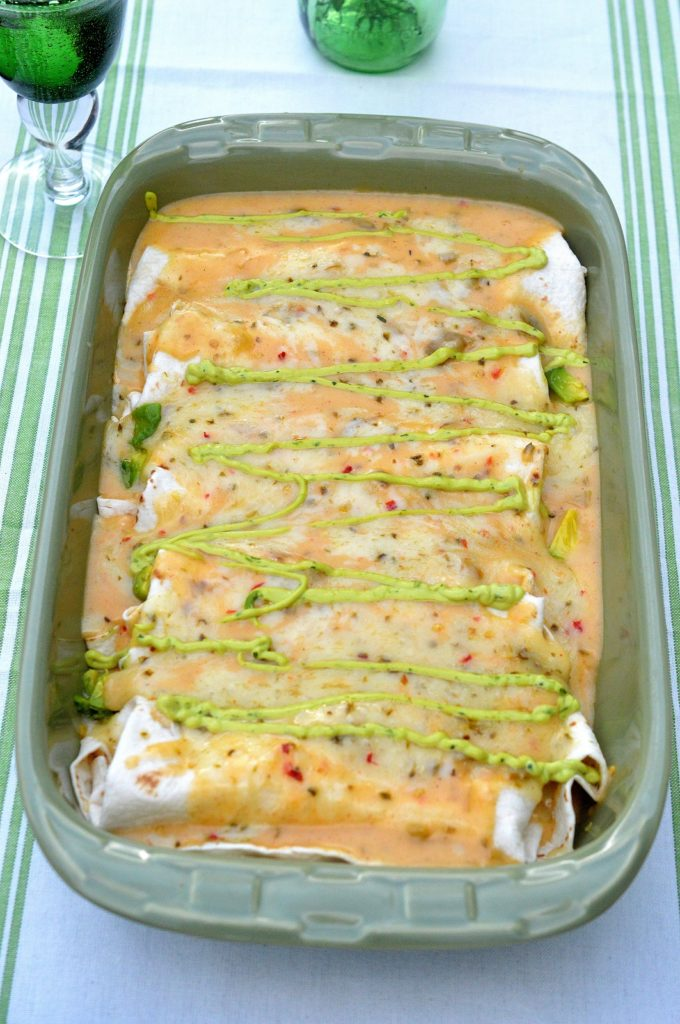 Spicy White Chicken Enchiladas with Avocados and a Spicy Creamy Guacamole Cream Drizzle