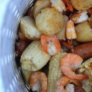 Shrimp Boil with Shrimp Potatoes Corn and Sausage made on the grill in a turkey fryer
