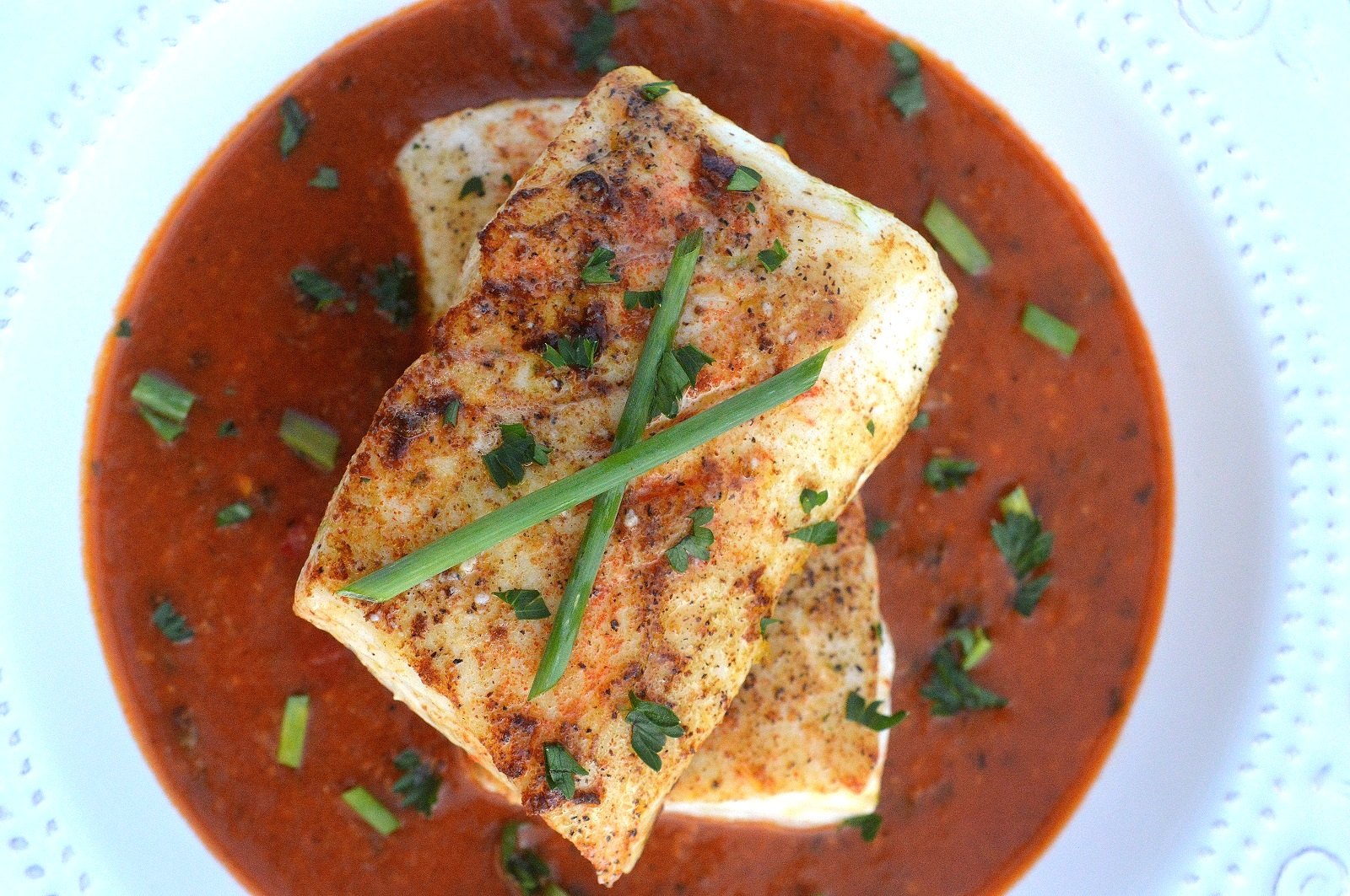 Pan Seared Halibut Over Thai Curry Sauce ready in 30 minutes or less and one of the best bites I have had!
