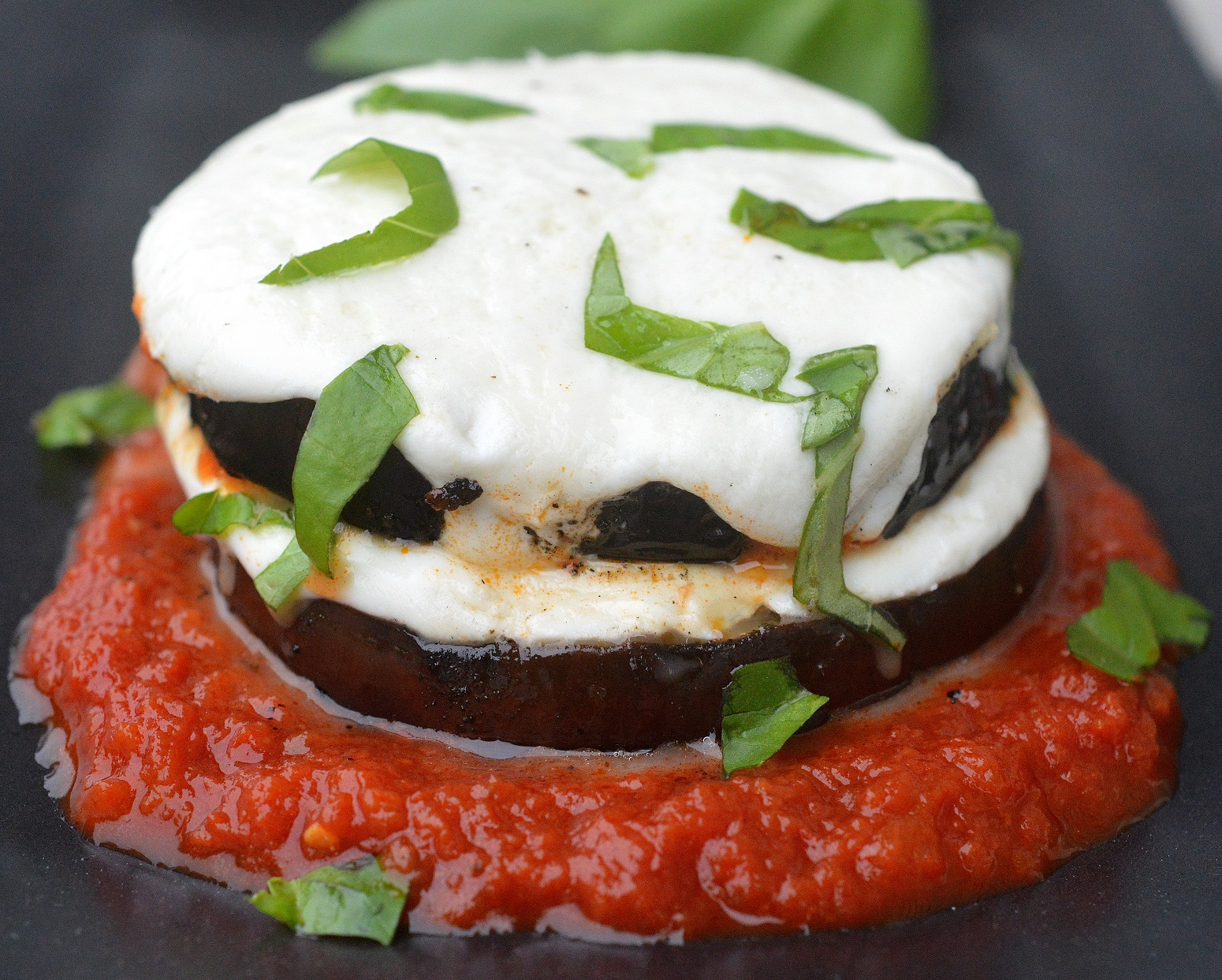 Grilled Eggplant Parmesan. A lightened up version of the original perfect for grilling season! Low carb & gluten free recipe.