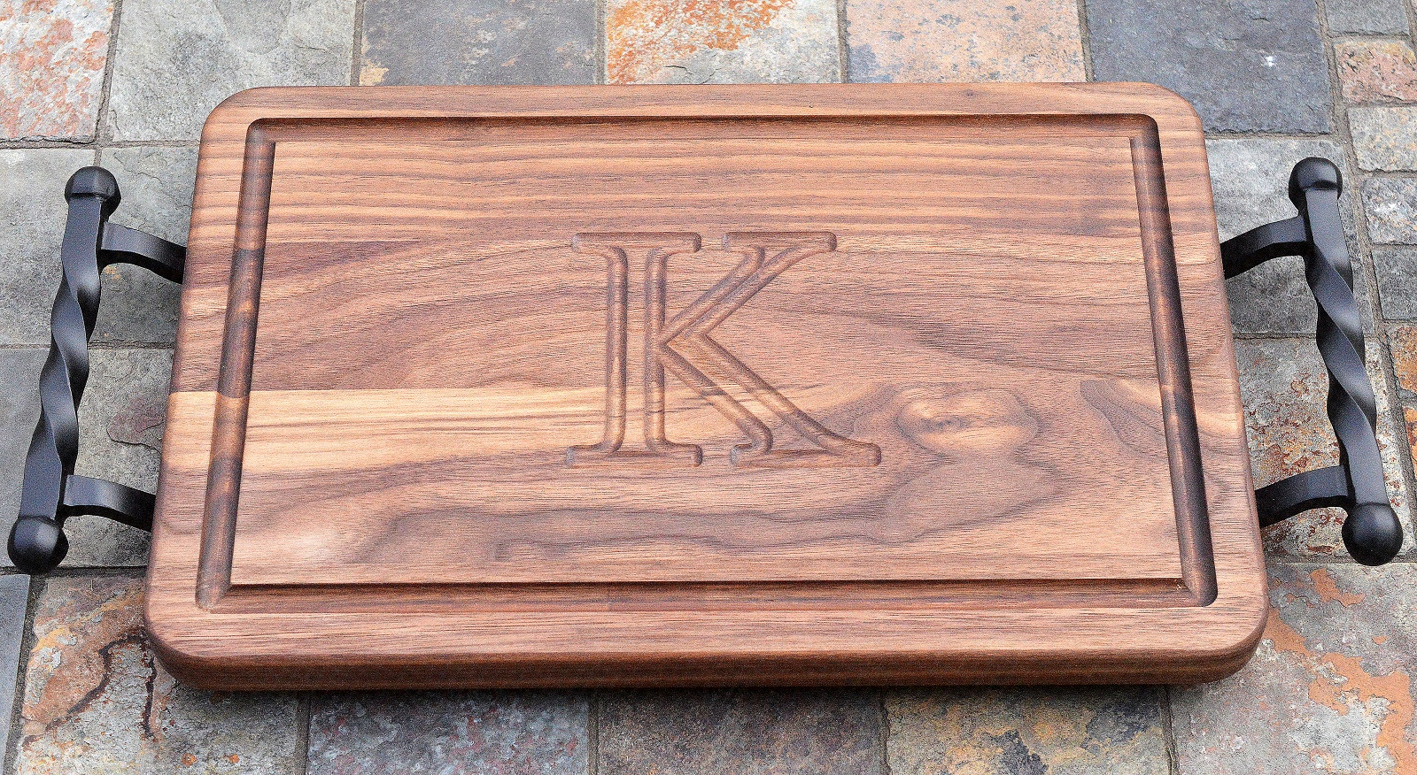 Walnut Wood Twisted Iron Monogramed Cutting Board made in the USA from www.cuttingboard.com