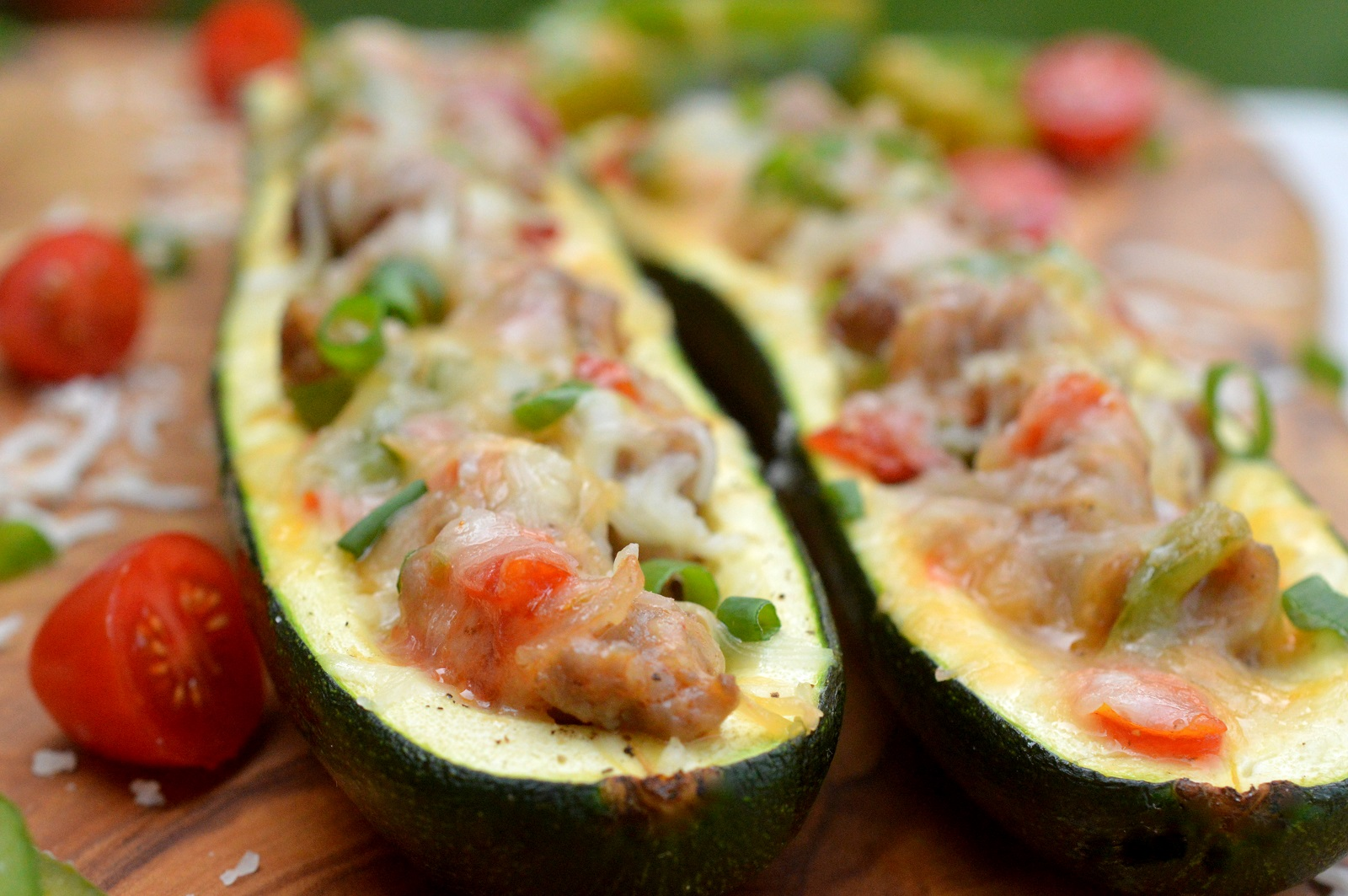 Breakfast Sausage, Pepper, Onion, Tomato and Cheese Stuffed Zucchini THIS is unbelievably delicious for breakfast, lunch or dinner!