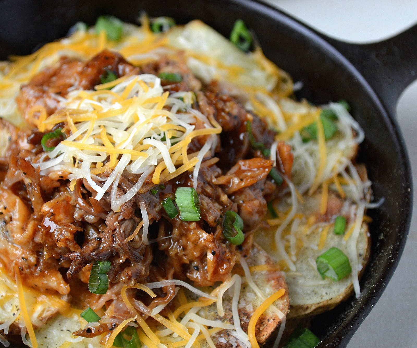 Pulled Pork Potato Nachos are a flavor explosion and a great gluten free offering!