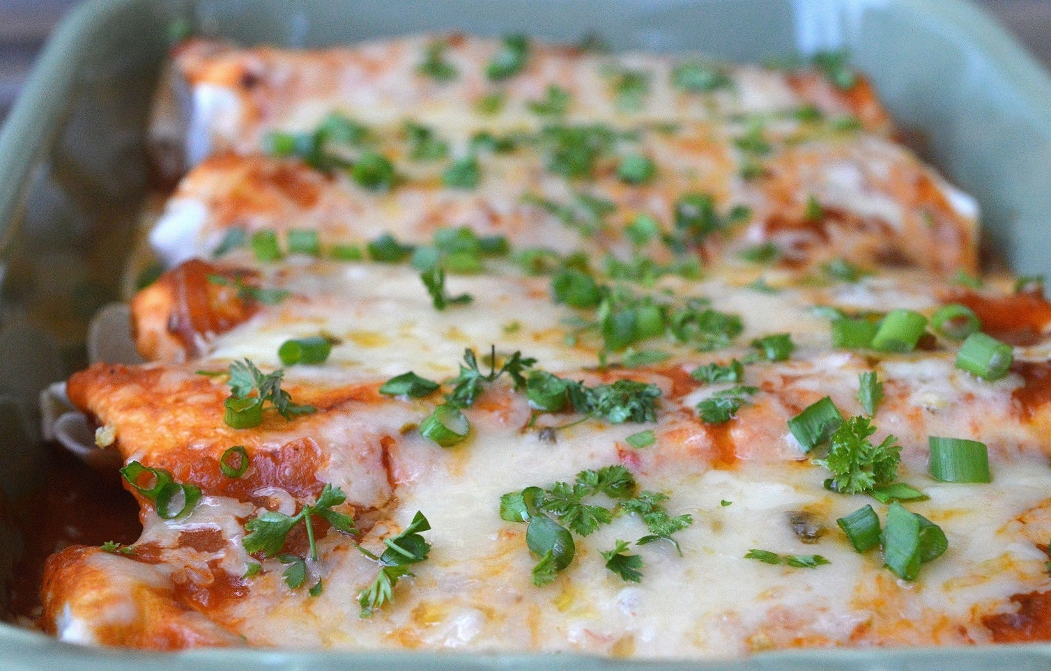 Incredibly delicious recipe for Beef Enchiladas with homemade sauce. You want these in your life!