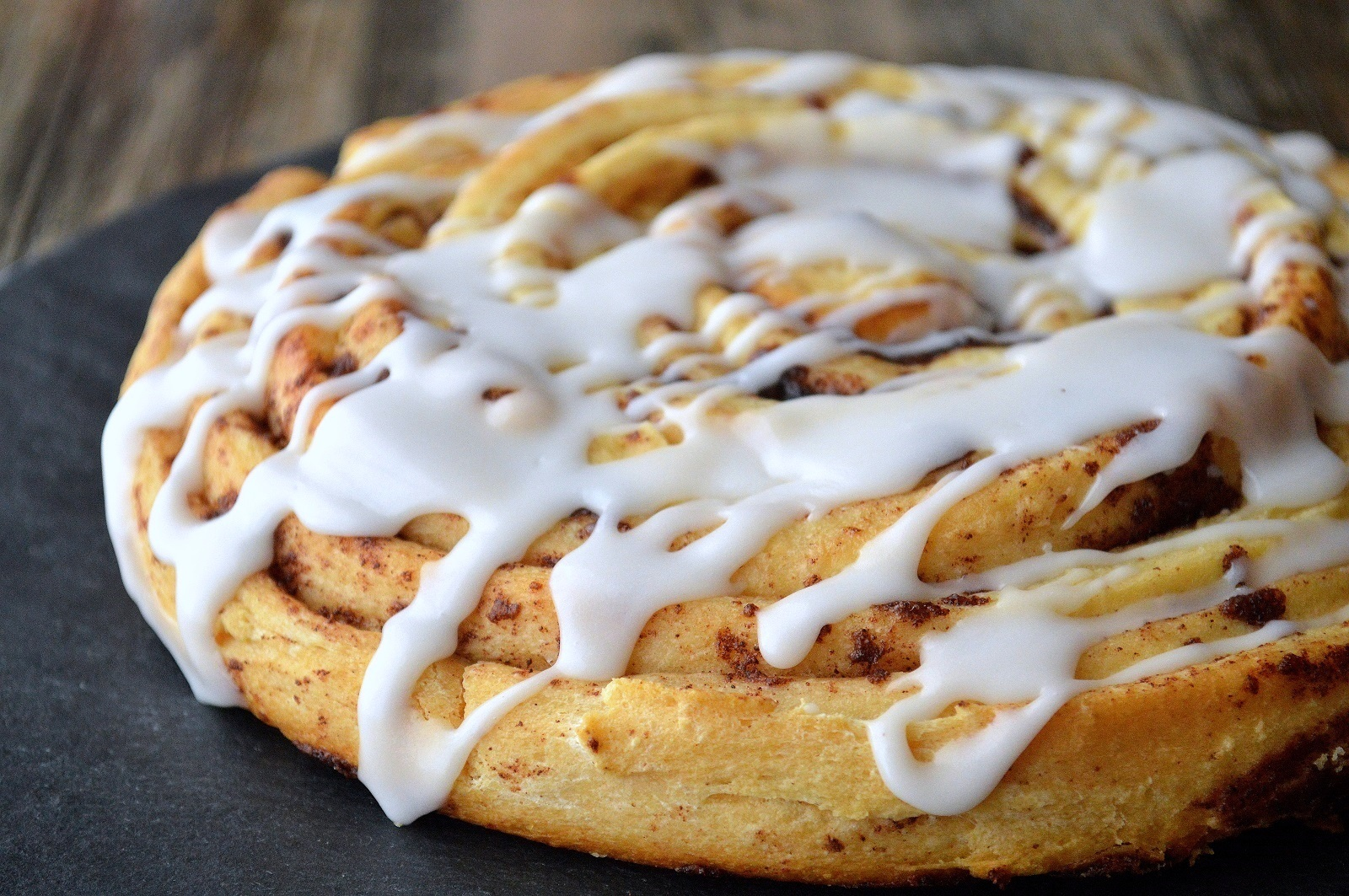 Giant Cinnamon Bun Cake! It's fun, moist & delicious and all you need is a can of Pillsbury Grands Cinnamon Buns!