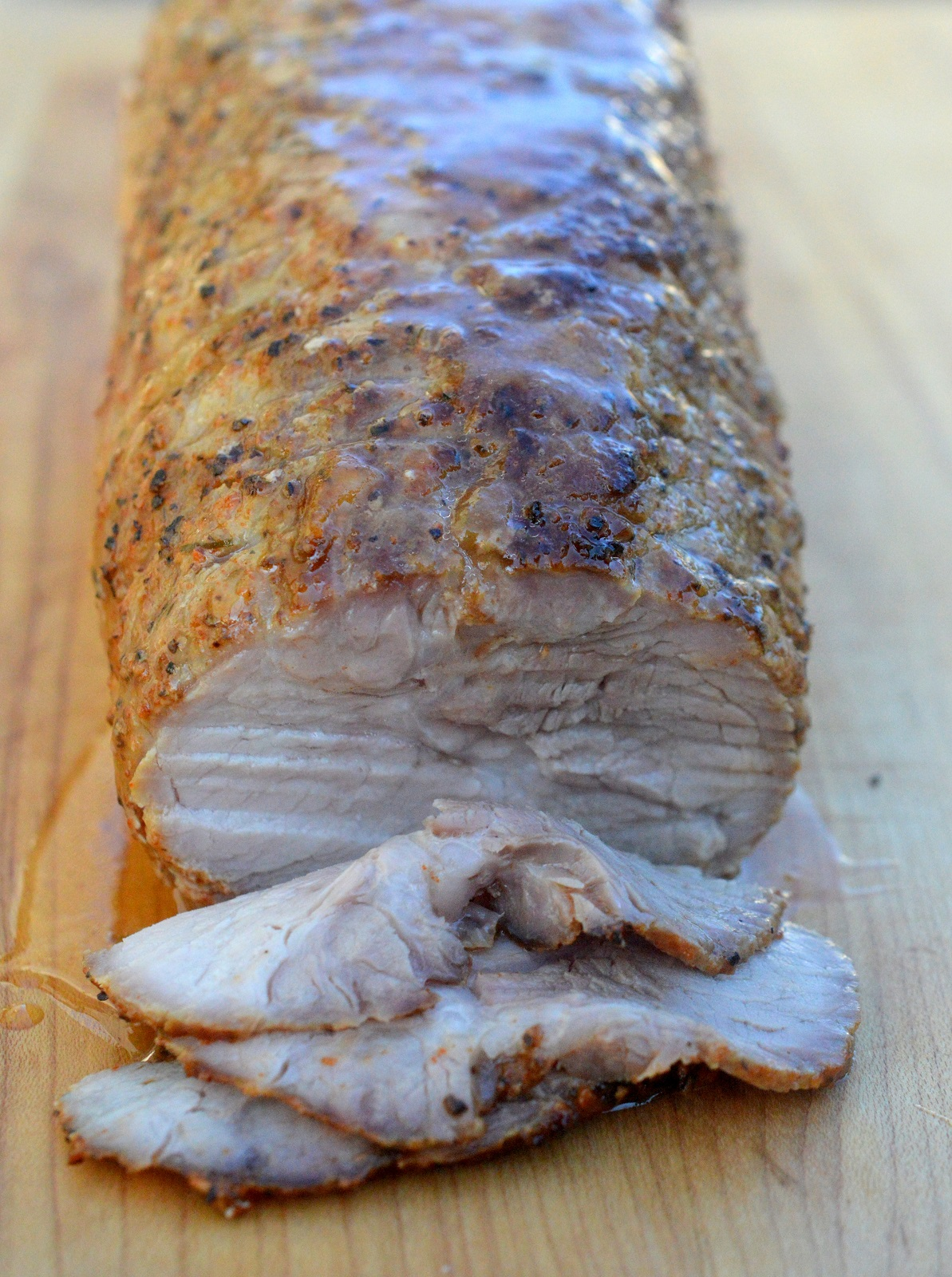 The pork is rested from the previous day's roasting and ready for slicing to make a Philly Roast Pork Sandwich