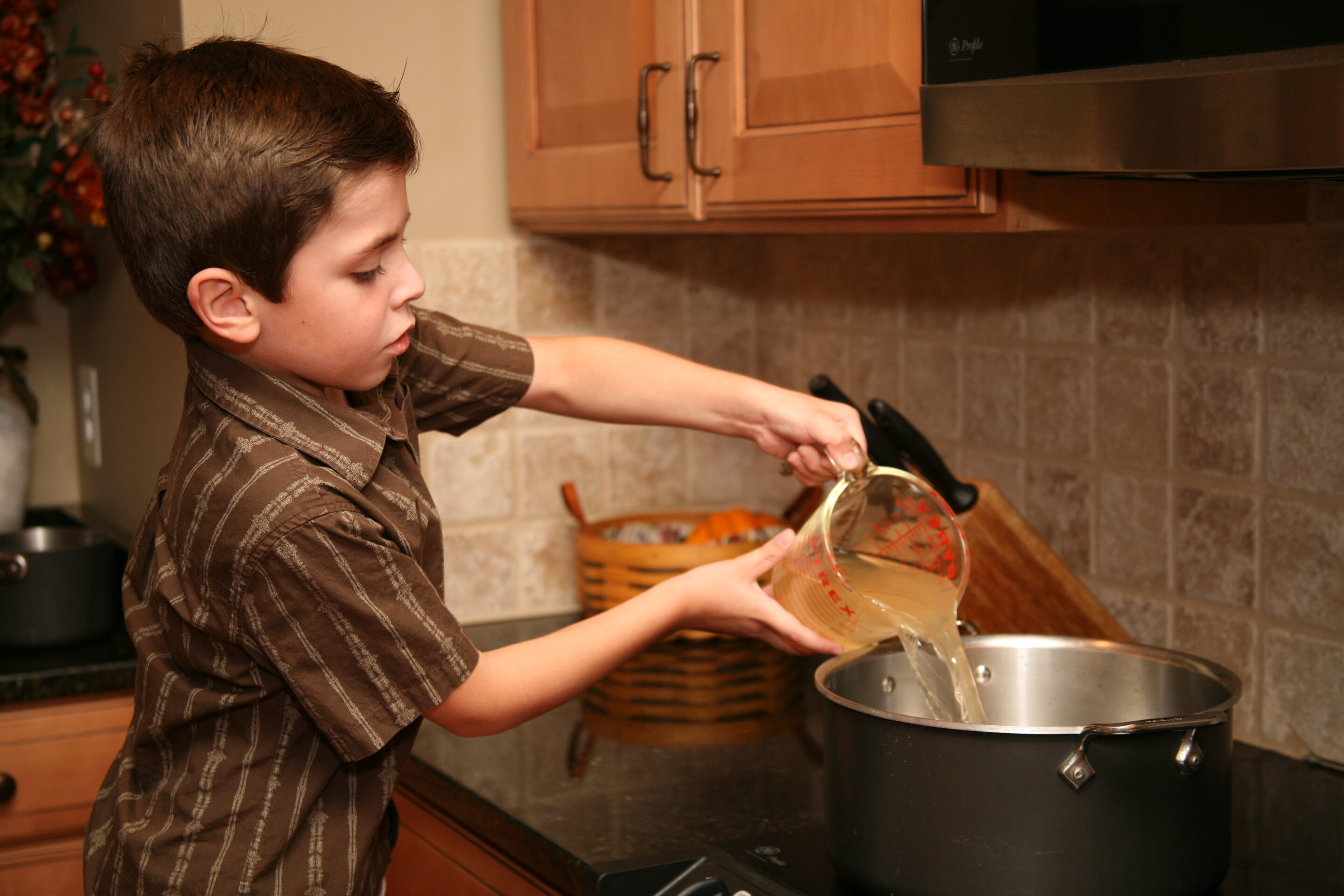 Young boy cooking