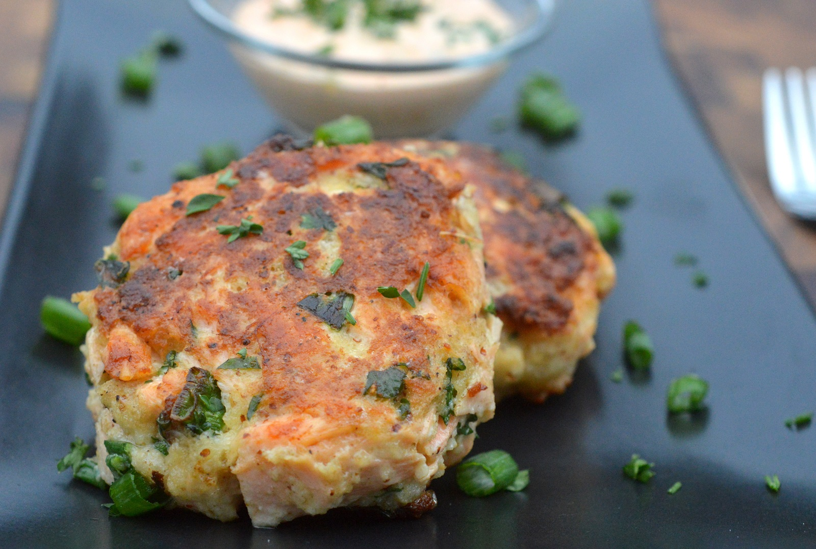 Image of cooked salmon cakes on a plate.
