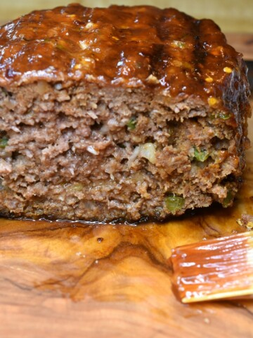 Meatloaf cooked on the grill, ready to be enjoyed, sliced open.