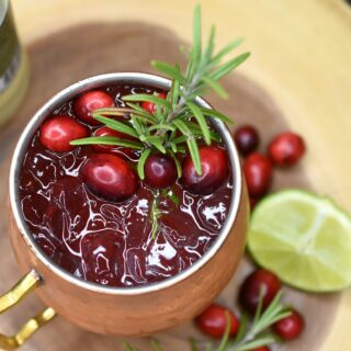 Cranberry Moscow Mule cocktail in copper mug